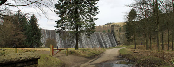 A dramatic curtain of water falls over the Upper Derwent Reservoir dam